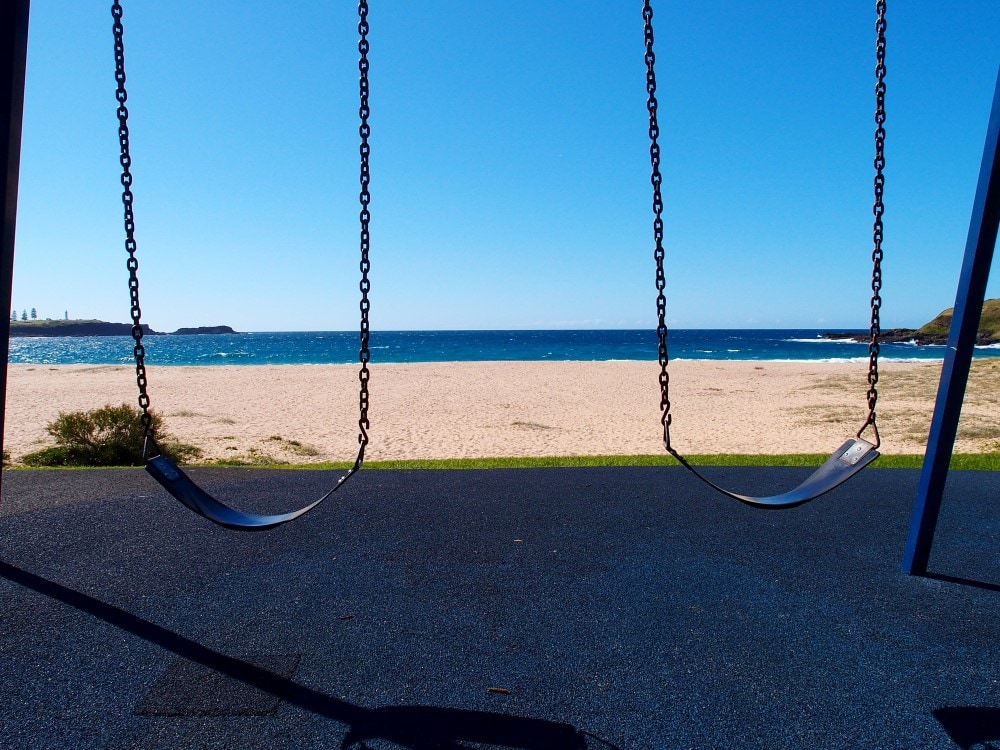 Kendalls Beach kids swing perfect view